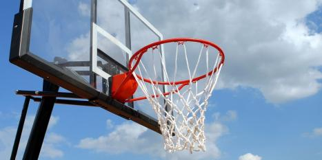 Basket ball hoop against blue sky
