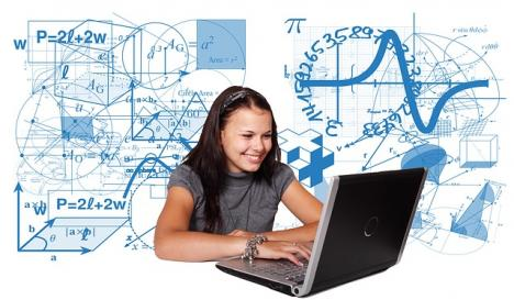 Smiling student looking at her laptop surrounded by blue mathematical equations and symbols