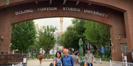 Insight Assessment conference participants standing under an arch at the Beijing Foreign Studies Universities