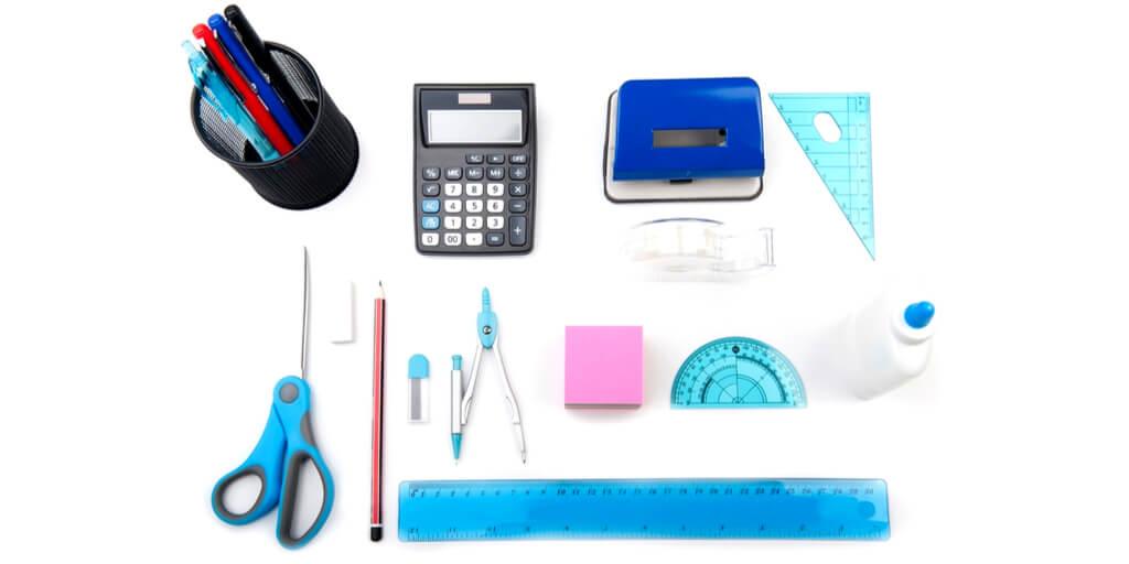 assortment of measurement tools including ruler, protractor, calculator, compass