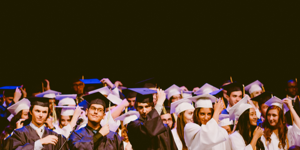 Students in graduation robes and mortarbords celebrating their graduation
