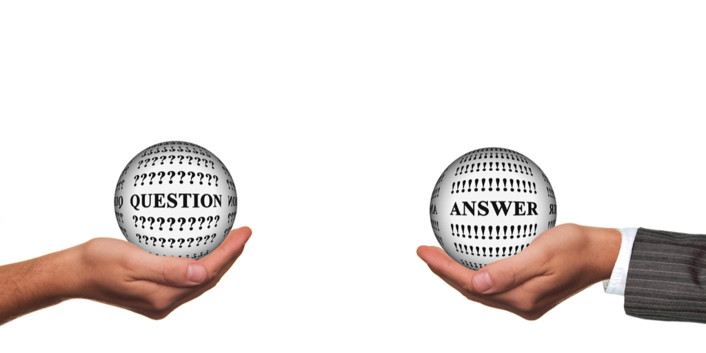 Image of two hands. One hand holds a ball with Question written on it; the other holds a ball with Answer written on it.