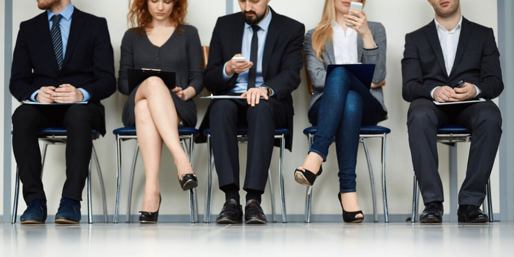 Job candidates sitting in line for an interview