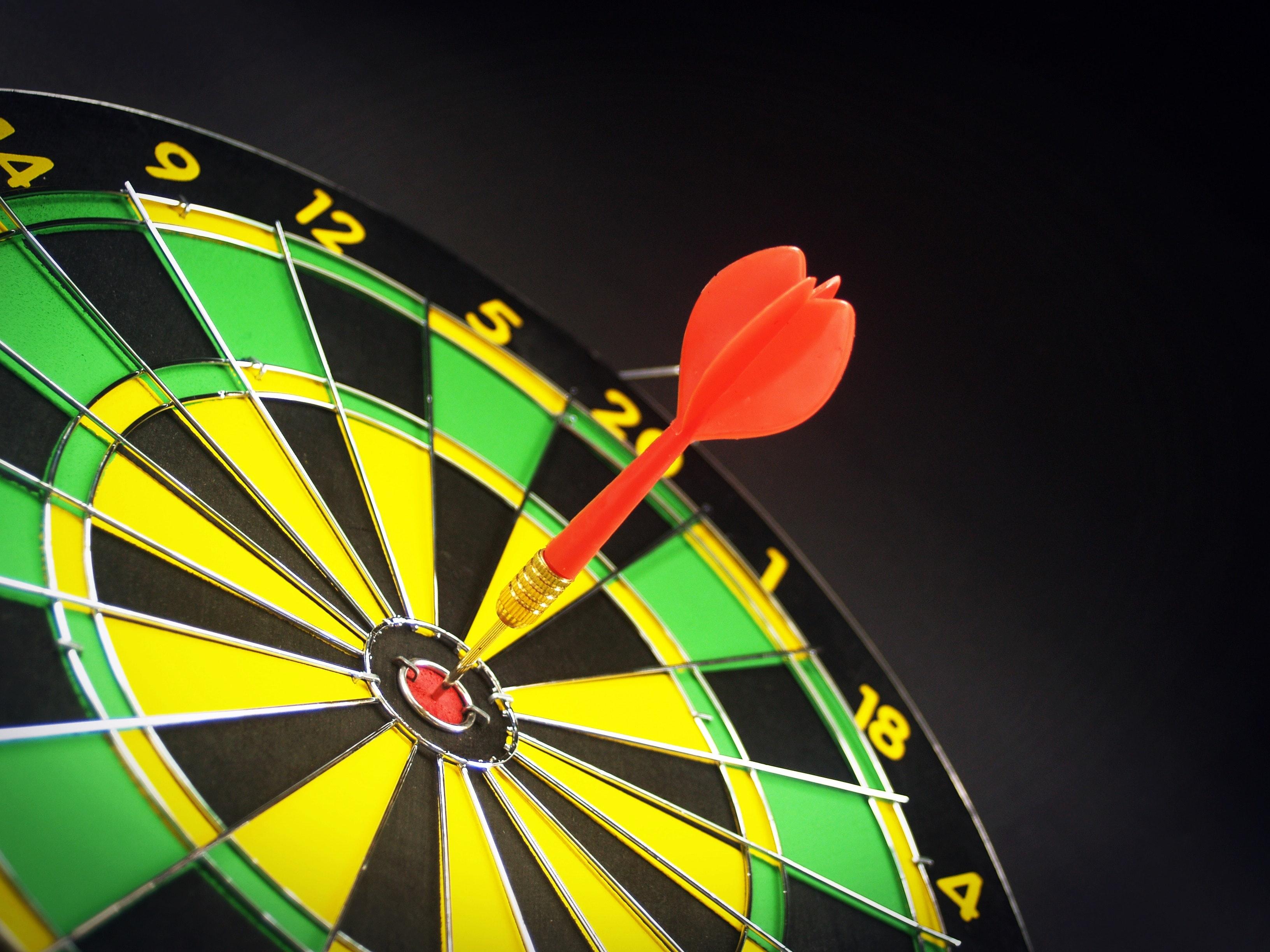 Bullseye!  Dart hitting the center of a dartboard