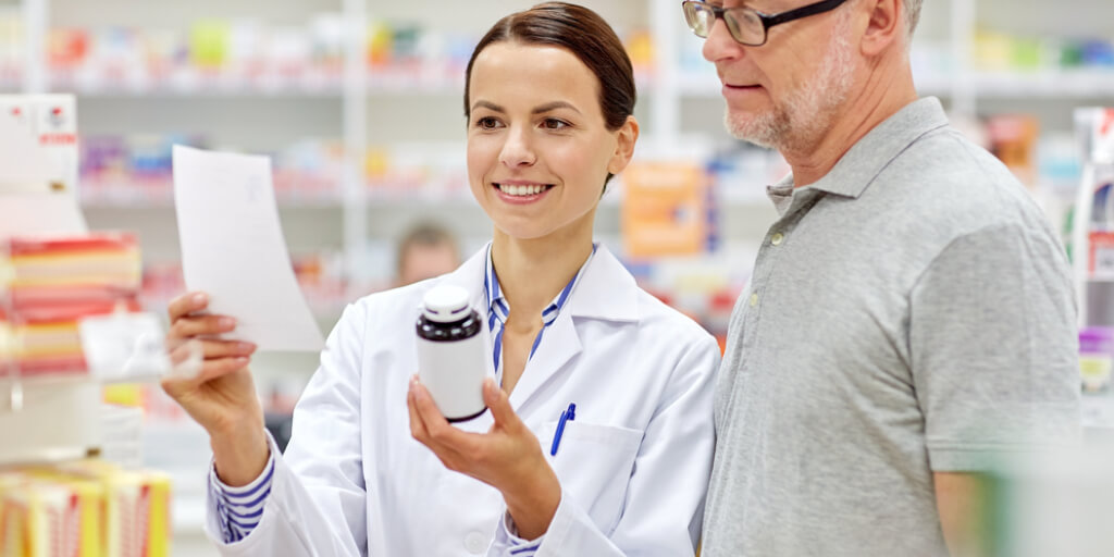 Pharmacist helping customer choose best meducube