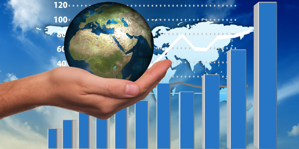 Hand holding globe infront of histogram showing an upward trend